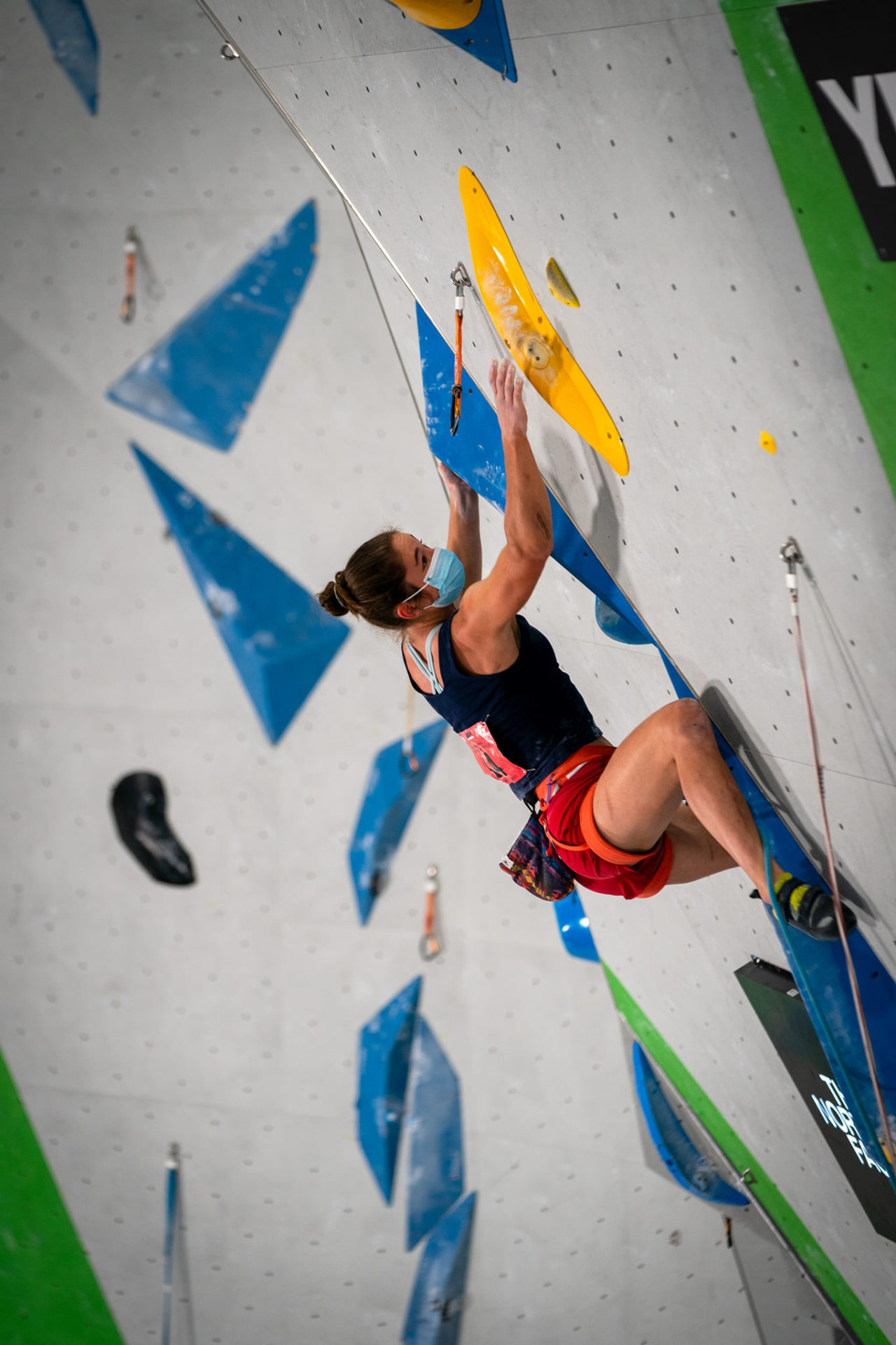 Female competitor on climbing wall