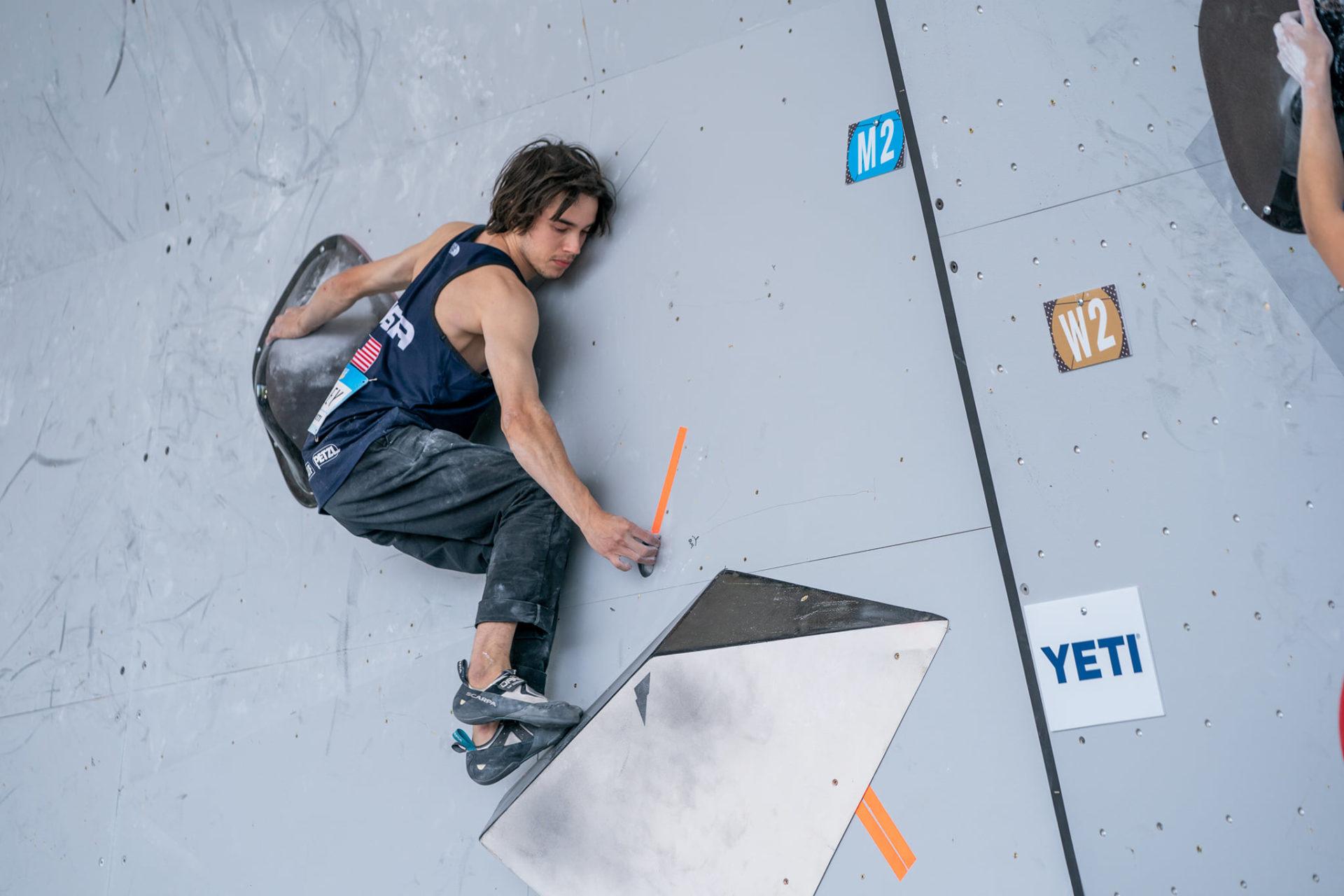 Male USA Climber on climbing wall