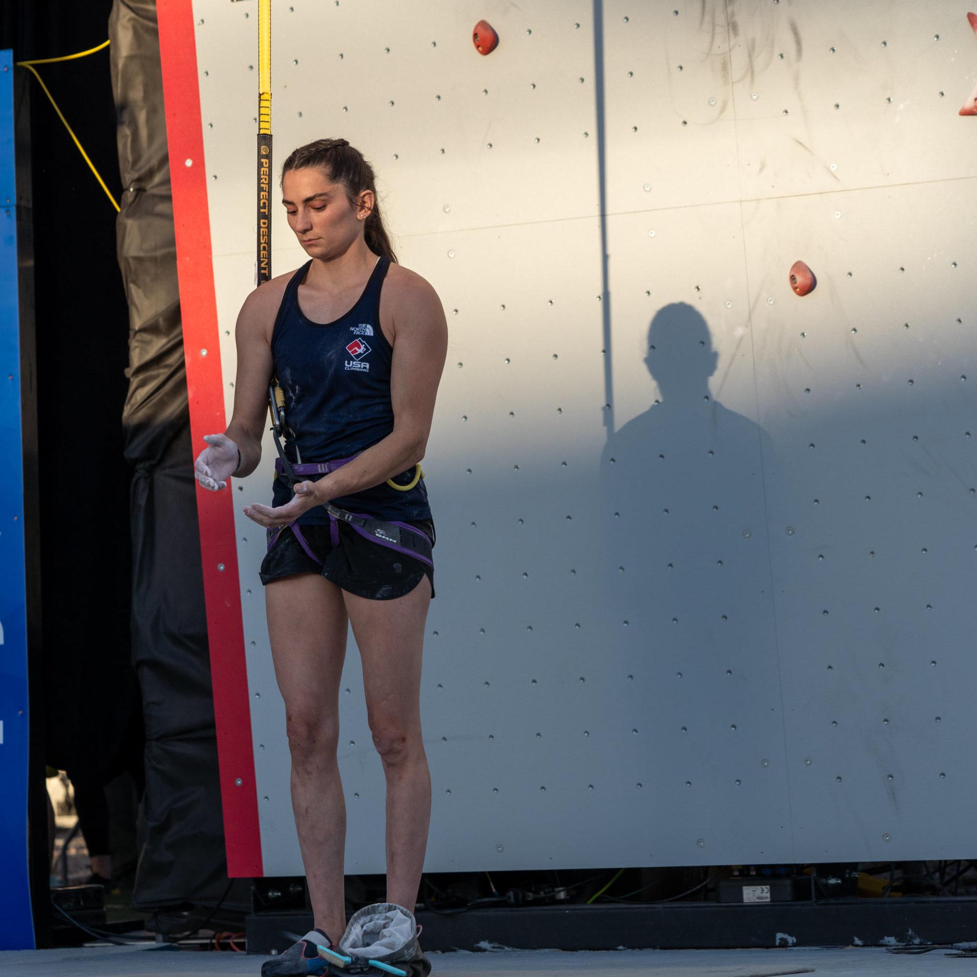 USA female climber chalking hands