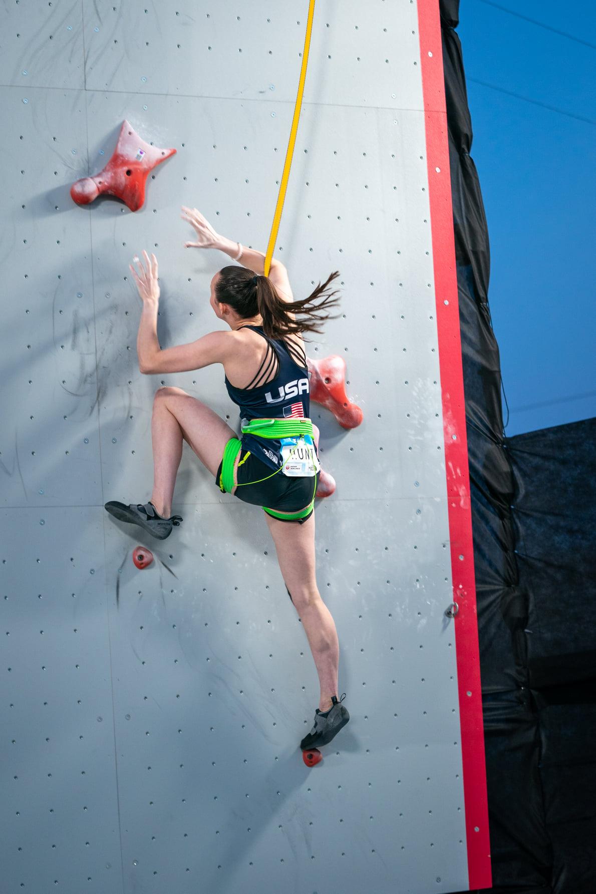 USA Climber Hunt on wall, mid reach