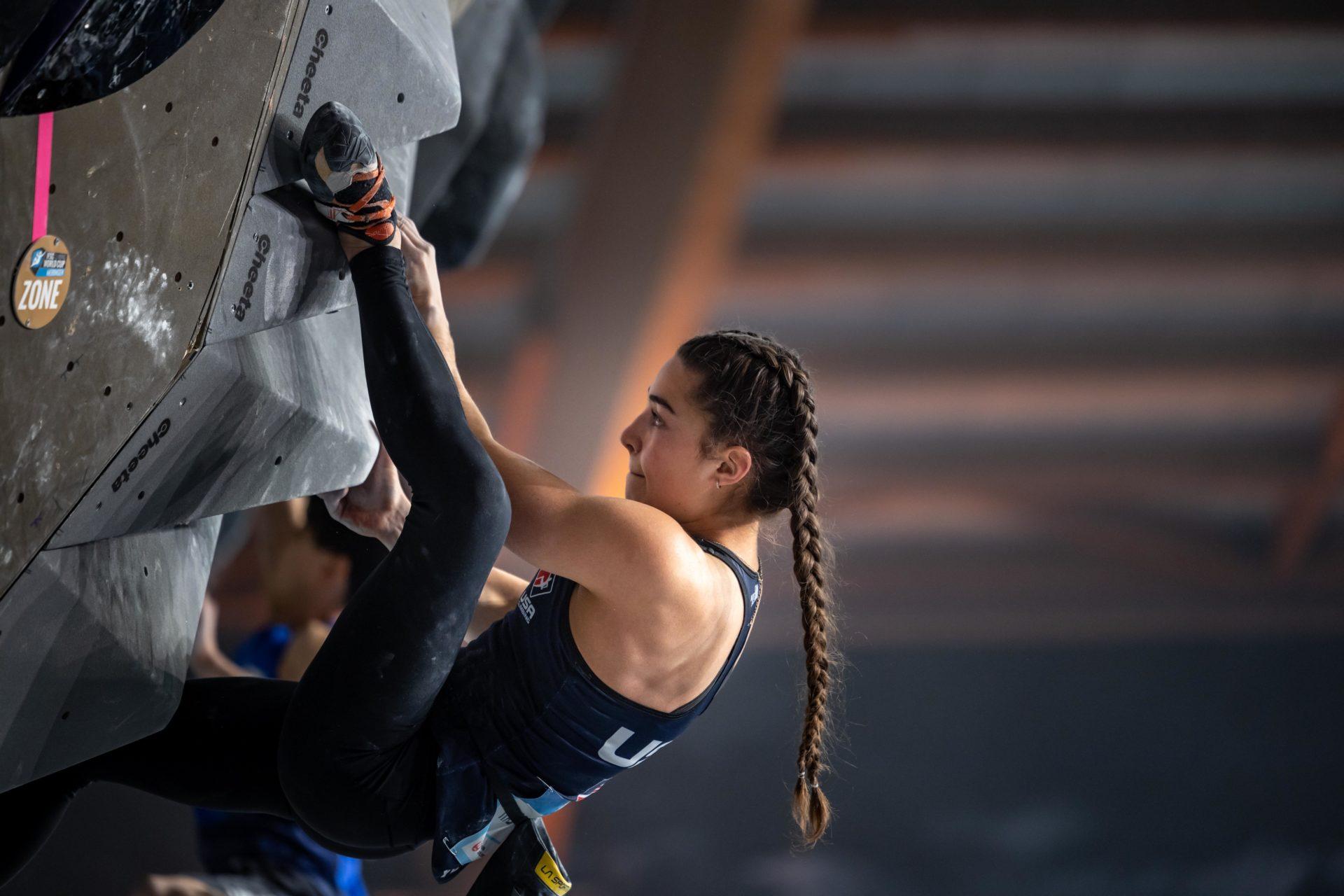 Female USA Climber on climbing wall