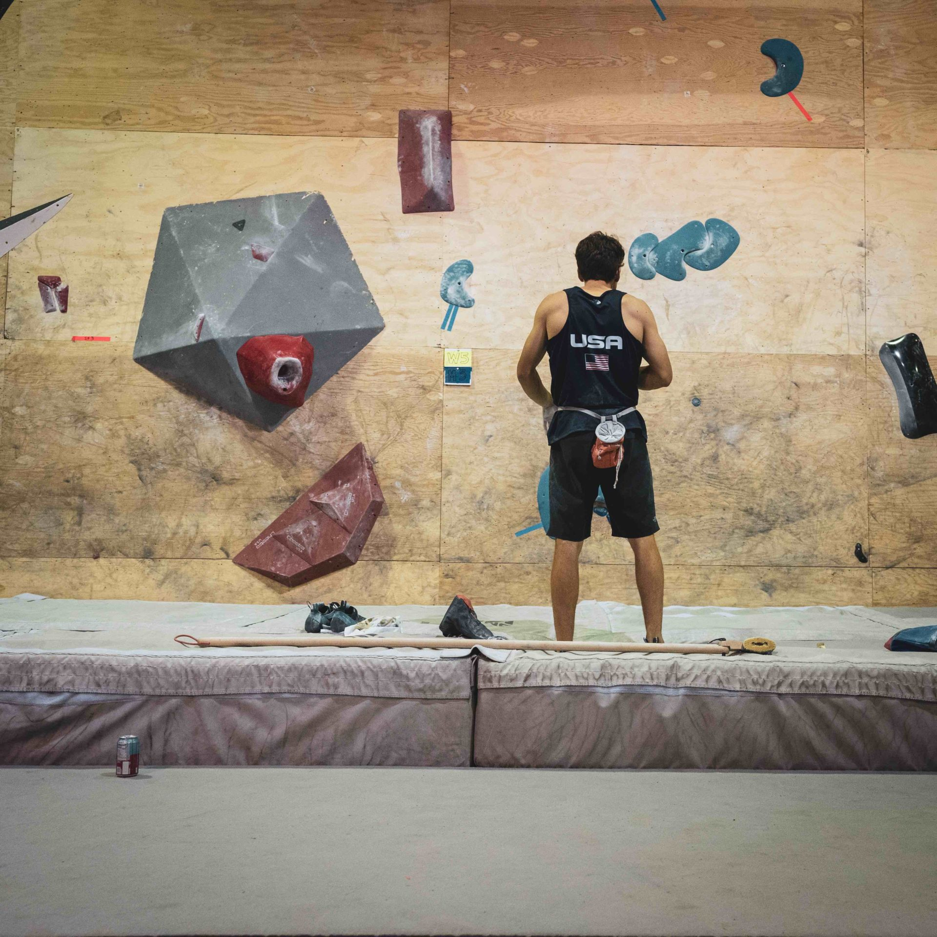 USA Climber standing in front of bouldering wall